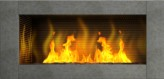 Contemporary modern living flame gas fire inset into wall providing instant heating on demand